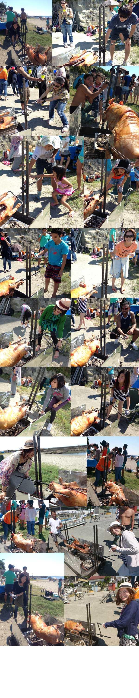 豚の丸焼き台でくるくると回転させながら焼く